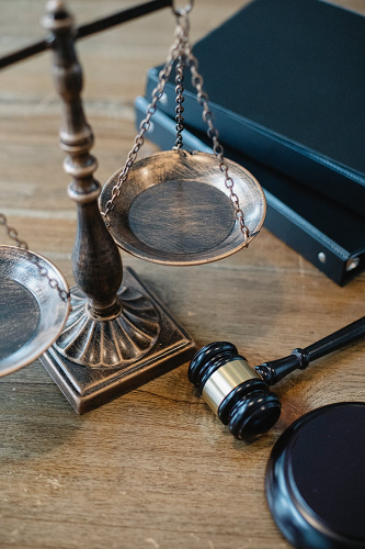 symbols-of-justice-and-law-on-table-of-judge